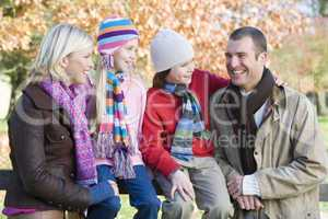 A young family in autumn outfit