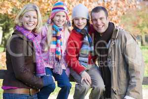 Family in the forrest in fall time