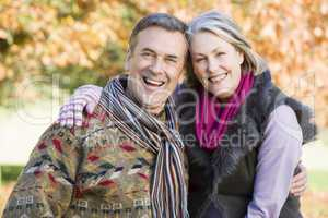 smiling elderly couple in the park