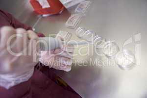 Embryologist preparing cultures