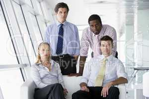 Four businesspeople in office lobby