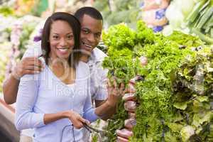 Couple buying fresh produce