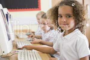 Girl working on a computer at primary school