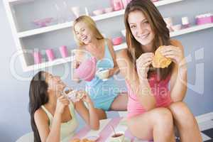Three young women in their underwear having a tea party