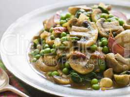 Mushroom and Pea Curry with Roasted Garlic on a Pewter Plate