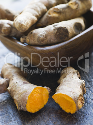 Pieces of Whole And Cracked Fresh Turmeric Root