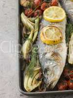 Whole Sea Bass Roasted with Fennel Lemon Garlic and Cherry Tomat