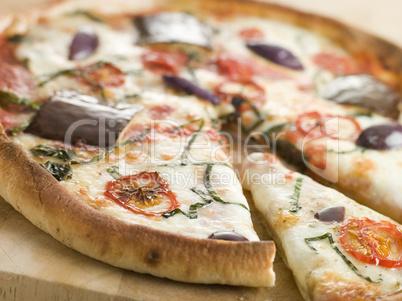 Tomato Mozzarella Aubergine and Basil Pizza