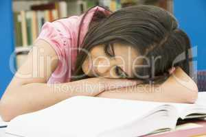 Exhausted university student in library