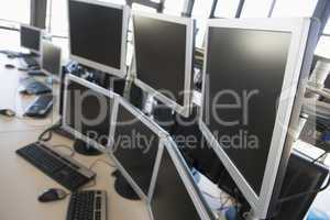 Empty office space with many monitors