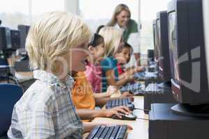Kindergarten children learning how to use computers.