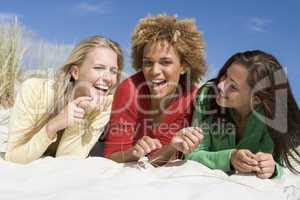 Three friends having fun at beach