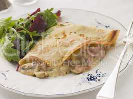 Savoury Pancake filled with Ham Cheese and Mushrooms with dresse