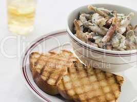 Fricassee of Frog Legs with Grilled Brioche