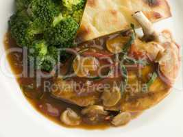 Sauteed Chicken Chasseur with Broccoli and Pomme Anna