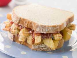 Chip Sandwich on White Bread with Tomato Ketchup