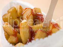 Chip Shop Chips in a Bag with a Wooden Fork and Tomato ketchup