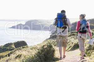 Couple on cliffside outdoors walking