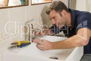 Plumber working on sink