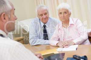 Couple in doctor's office frowning