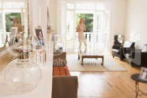 Woman in living room talking on telephone