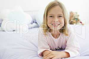 Young Girl Lying On Her Bed In Her Pajamas