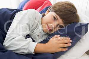 Young Boy Lying Down In His Bed