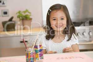 Young Girl Drawing Pictures