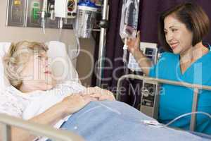 Doctor Checking Up On Senior Woman