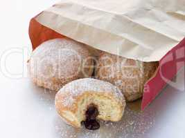 Bag Of Raspberry Jam Doughnuts With A Bite Taken