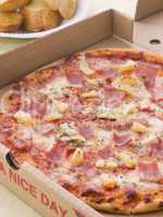 Hawaiian Pizza In A Take Away Box With Garlic Bread