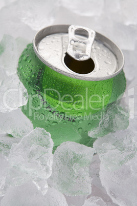 Green Can Of Fizzy Soft Drink Set In Ice With The Ring Pulled