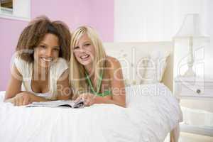 Teenage Girls Lying On Bed