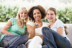 Teenage Girls Sitting On Couch