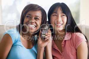 Teenage Girls Talking On Telephone