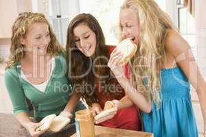 Teenage Girls Making Sandwiches