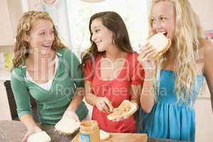 Teenage Girls Making Sandwiches