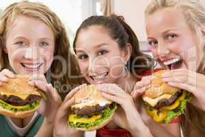 Teenage Girls Eating Burgers