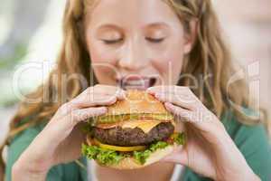 Teenage Girl Eating Burgers