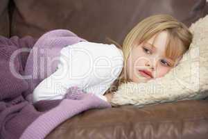 Young Girl Unwell Lying On Sofa