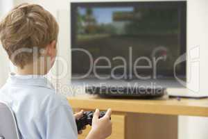Young Boy Playing With Game Console