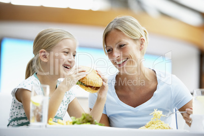 Mother And Daughter Having Lunch Together At The Mall