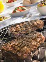 Steak Cooking On A Grill