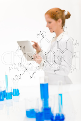 Woman scientist in laboratory with touch screen