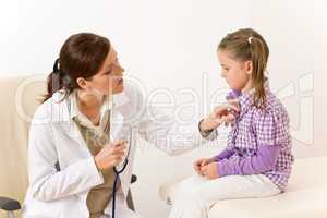 Female doctor examining child