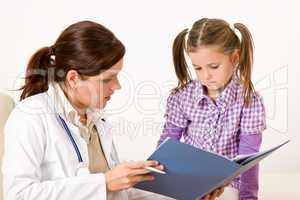 Female doctor with child at medical office