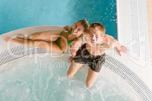 Top view - couple relax in swimming pool