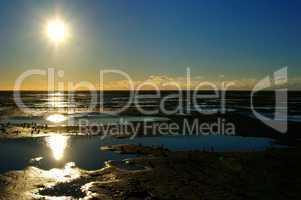 Sonnenuntergang im Wattmeer mit Prielen
