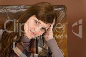 Hispanic woman on brown leather armchair