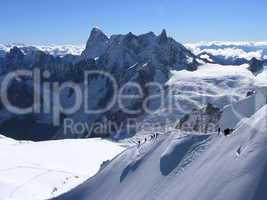 Bergwelt und Kletterer an der Aiguille du Midi